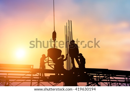 construction silhouette Over blur evening sky at sunset. over blurred  the evening sky at sunset. - stock photo