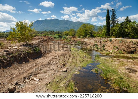 Construction site against a blue sky in Greece with dirt and excavated land in foreground. General construction scene - stock photo