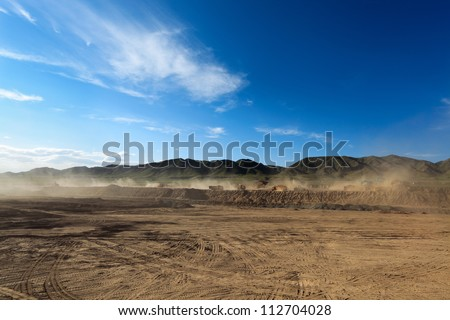 construction site against a blue sky,the dust was blown about by the wind - stock photo