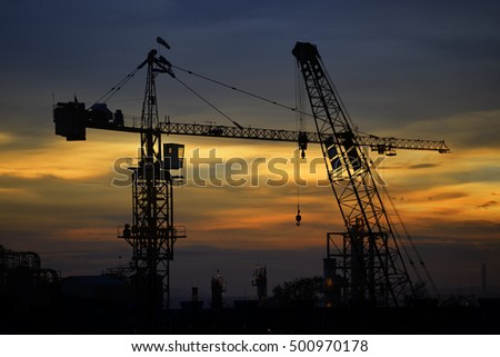 Construction site and sunset background.