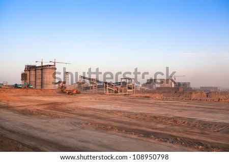 construction site at dusk in inner mongolia,is the construction of coal plants - stock photo