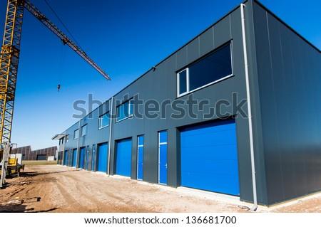 construction site building a new warehouse unit - stock photo