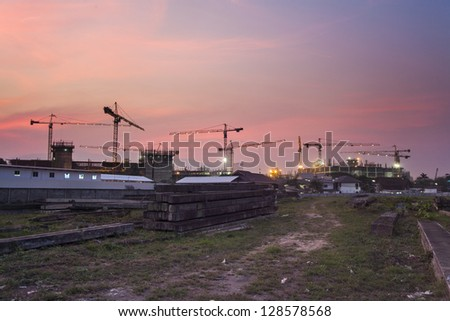 Construction site building with grass on the front - stock photo
