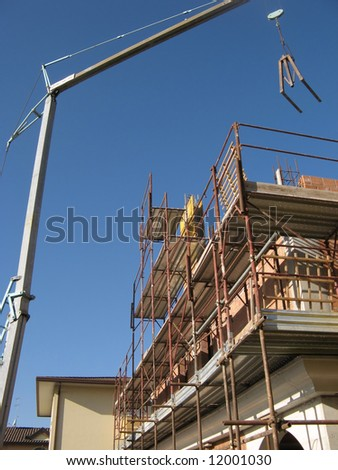 Construction Site: crane and scaffolding - stock photo