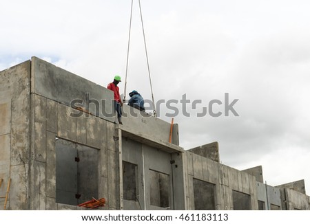 Construction site crane is used to placing precast concrete panels