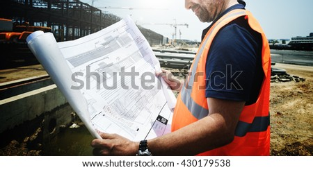 Construction Site Engineerer Working Blueprint Concept - stock photo