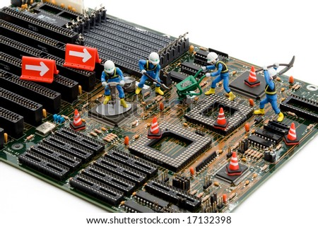 construction site - little workers repairing motherboard - stock photo