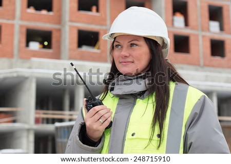 Construction site manager at at construction site is inspecting ongoing production - stock photo