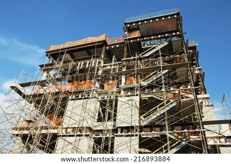 construction site of new school with scaffolding surrounding  - stock photo