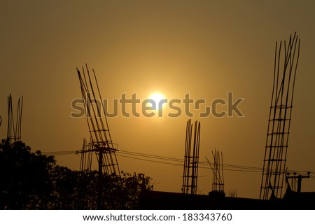 Construction site of the new retail building at sunset,Silhouette