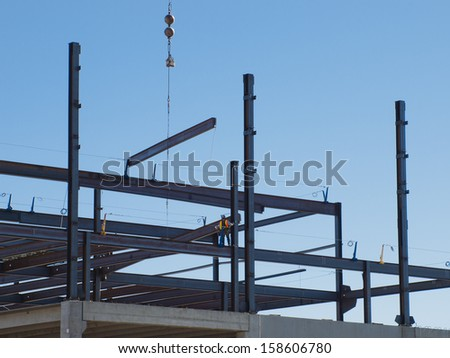 Construction site of the new retail building. Steel frame construction.