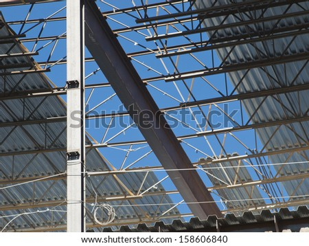 Construction site of the new retail building. Steel frame construction. - stock photo