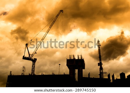 Construction site silhouette,color filter effect - stock photo