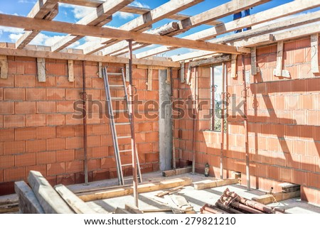 Construction site tools and details - metal ladder, brick layers, wood and timber - stock photo