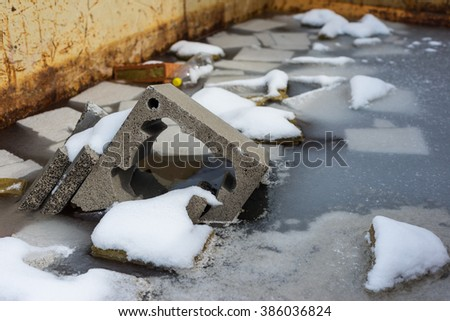 construction site trash and rubbish in metal container - stock photo