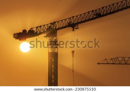 Construction site under sunset - stock photo