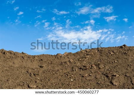 Construction site with a blue sky background.