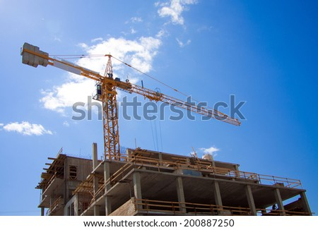 construction site with a high crane - stock photo