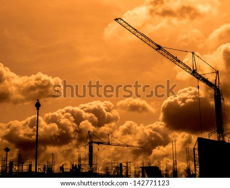 Construction site with cloudy sky in the evening