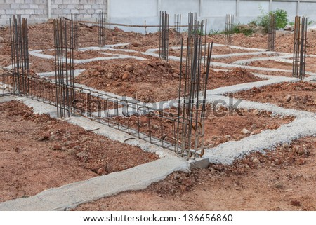 Construction site with  concrete steel frames - stock photo