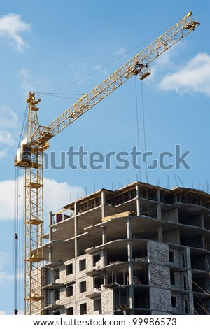 Construction site with crane and building against the sky
