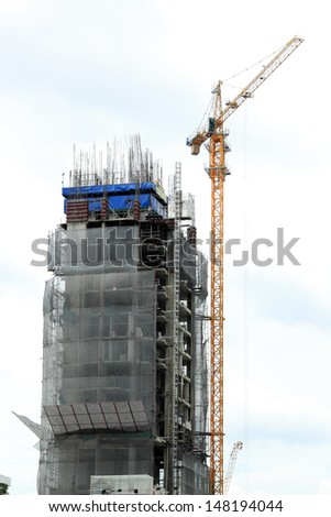 Construction site with crane and building in downtown of bangkok thailand  - stock photo