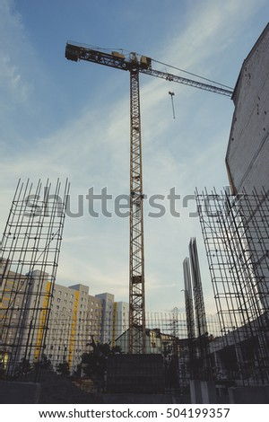 Construction site with crane and building, View from bottom
