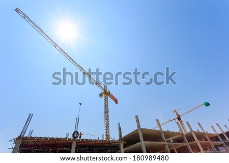 Construction Site with crane on blue sky  - stock photo