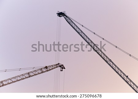 Construction site with crane -  silhouette style - stock photo