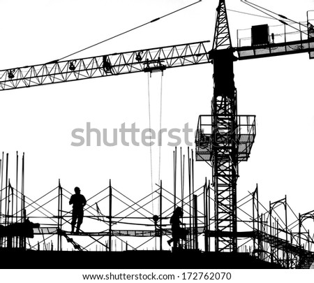 Construction site with crane, workers and scaffolding seen as a silhouette