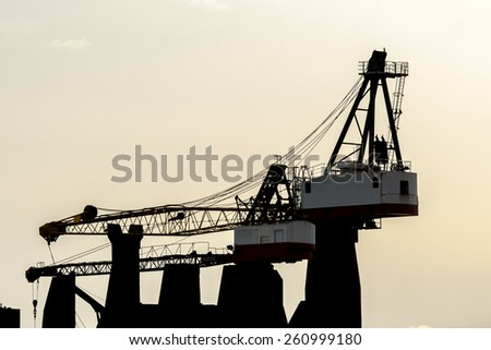 Construction site with cranes at sunset, sunrise, dawn time with the cranes as a silhouette. Vancouver, Canada. Horizontal. - stock photo