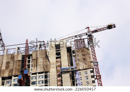 Construction site with cranes on sky background
