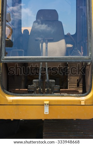 Construction Site with Excavator Driver's Cabin  - stock photo
