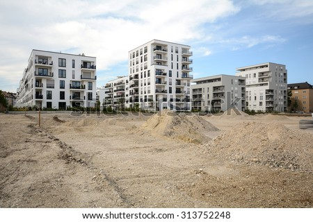 Construction site with new modern apartment buildings - low-energy houses - stock photo