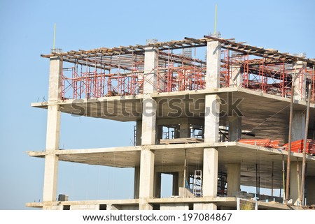 Construction site with scaffolding against blue sky