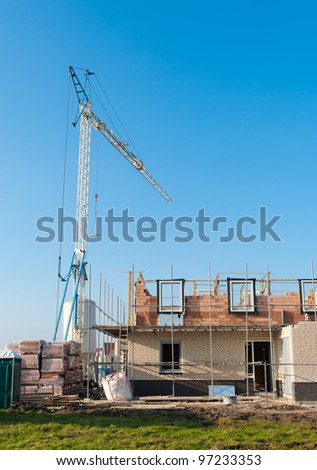 construction site with scaffolding and a crane