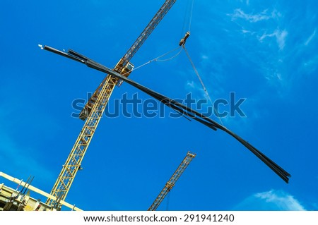 Construction site with tower cranes - stock photo