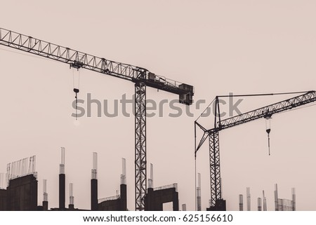 Construction site with two tower cranes