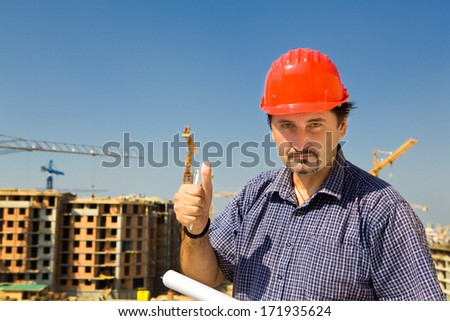 Construction site worker looking at camera  - stock photo
