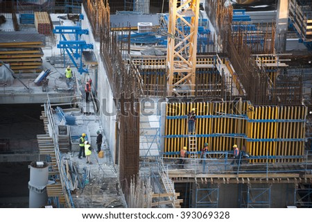 Construction site workers - Aerial - stock photo