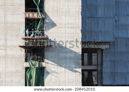 construction site workers on the 9th floor - stock photo