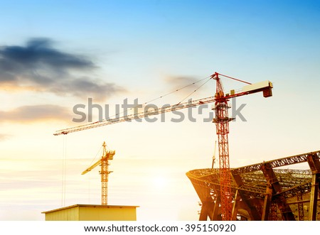 Construction sites, cranes and huge steel structure. - stock photo
