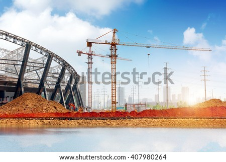 Construction sites, steel structures and cranes under the blue sky. - stock photo