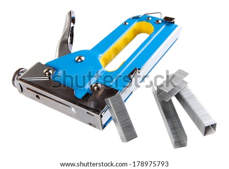 Construction stapler and staples isolated on white