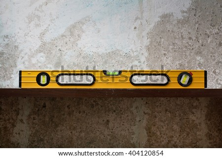 Construction tool Bubble spirit level on line at concrete background. Copy space for text - stock photo
