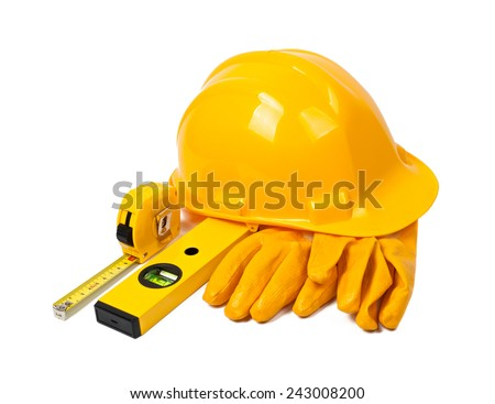 Construction tools on white background. Arrangement of hard hat, water gauge, leather gloves and measuring tape.   - stock photo