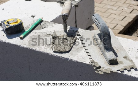 Construction tools, pencil, tape measure, mason float and brick trowel