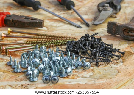 construction tools: pliers, hammer, shears, screwdriver, ommerce and screws - stock photo