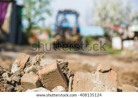 construction, tractor, construction debris, cleaning, cottage, country house - stock photo