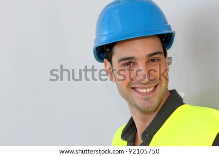 Construction trainee with security helmet - stock photo
